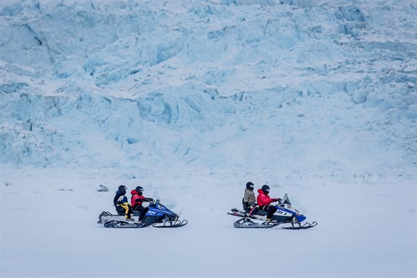 A Snowmobile Trip Along A Glacier Wall Near Ilulissat In Greenland