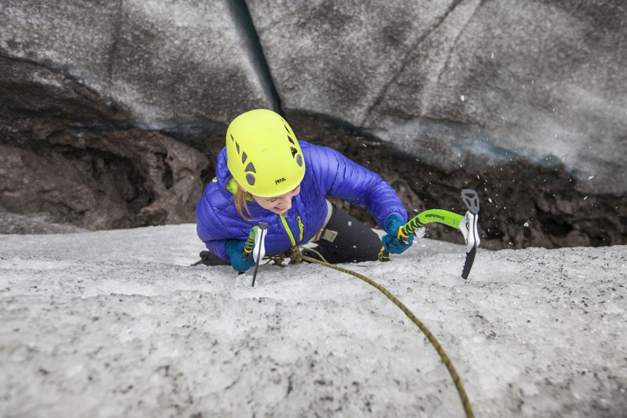 Girl ice climbing in Iceland in the south shore - South Shore Glacier Walk and Ice Climbing with Iceland Mountain Guides
