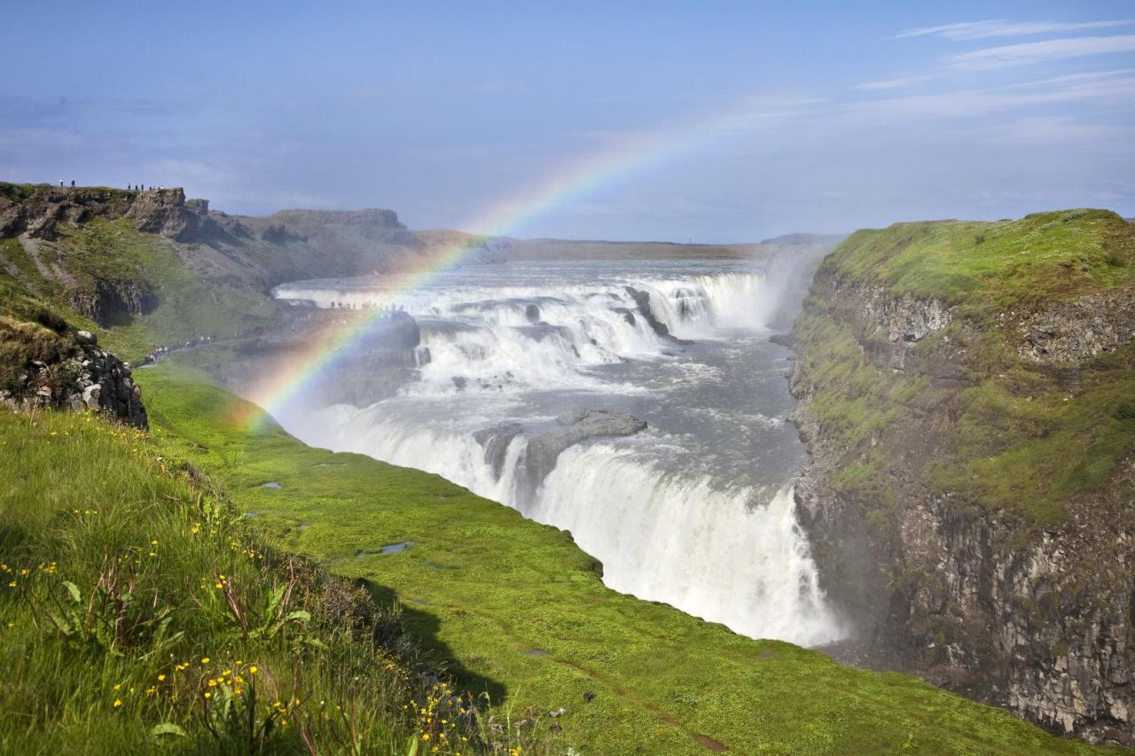 Rainbow over the famous Gullfoss waterfall - part of the Golden Circle | Icelandic Mountain Guides