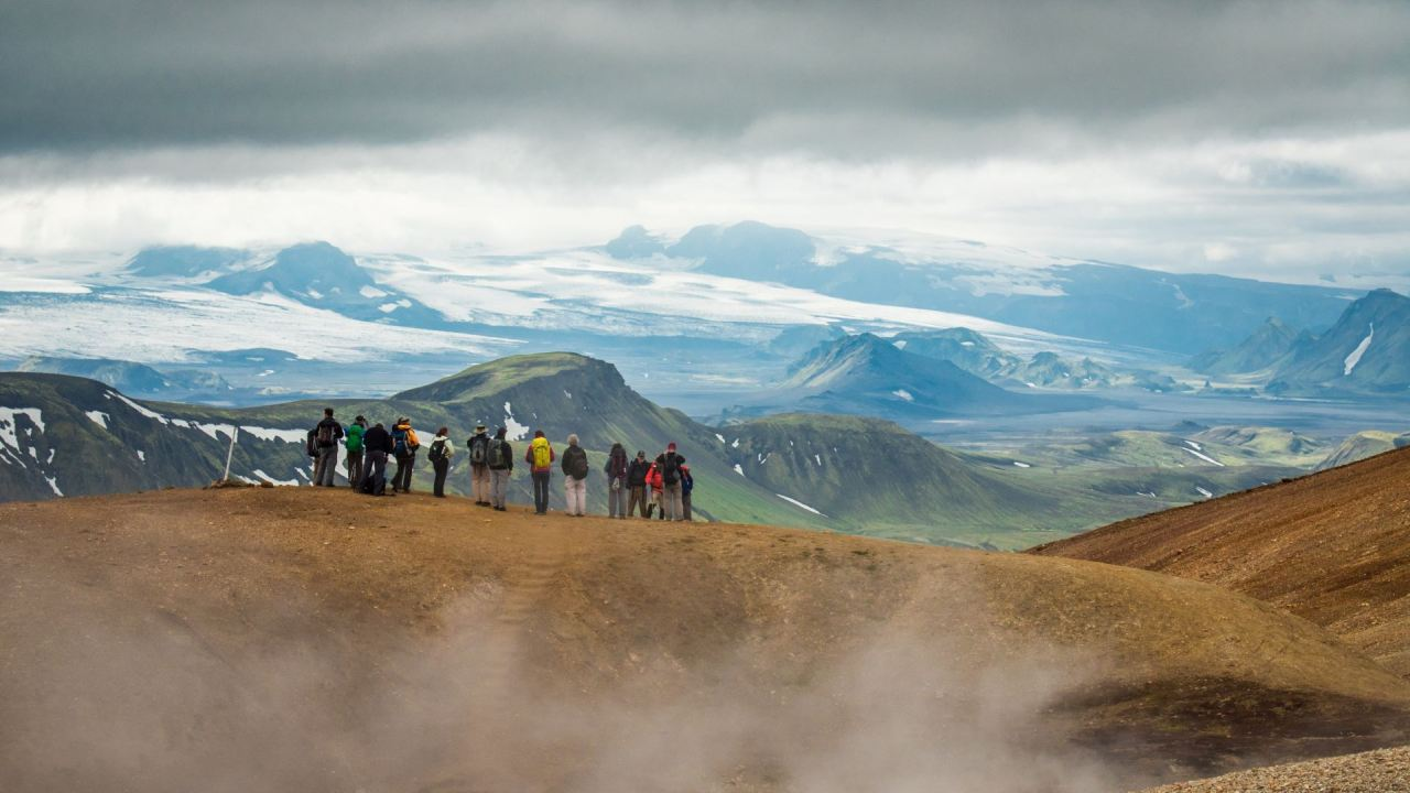 Hikers enjoying the view in Landmannalaugar's geothermal area on the Laugavegur trail   Icelandic Mountain Guides