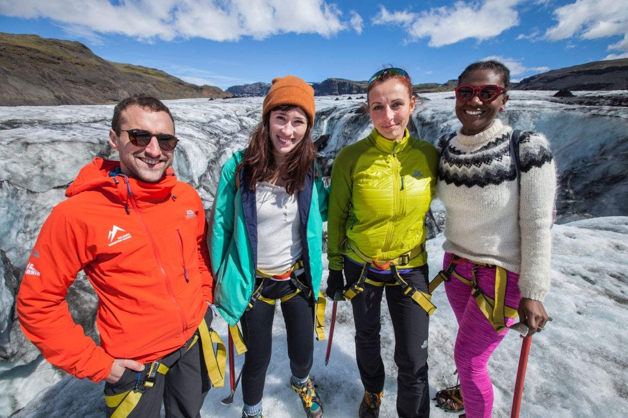 People smiling on the glacier of Solheimajokull in the south shore of Iceland - South Shore Glacier Walk and Ice Climbing with Iceland Mountain Guides