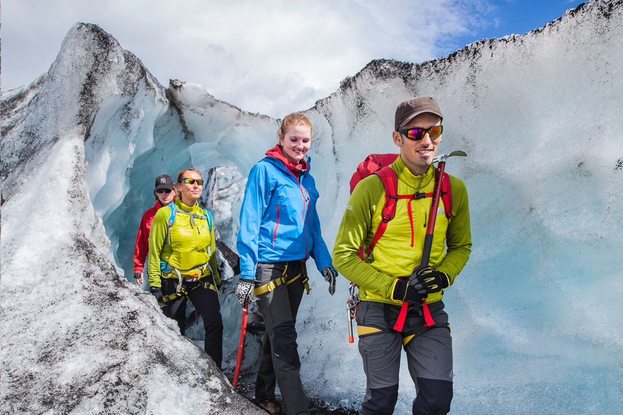 Walking through an ice tunnel on Solheimajokull - South Shore Glacier Walk and Ice Climbing with Iceland Mountain Guides