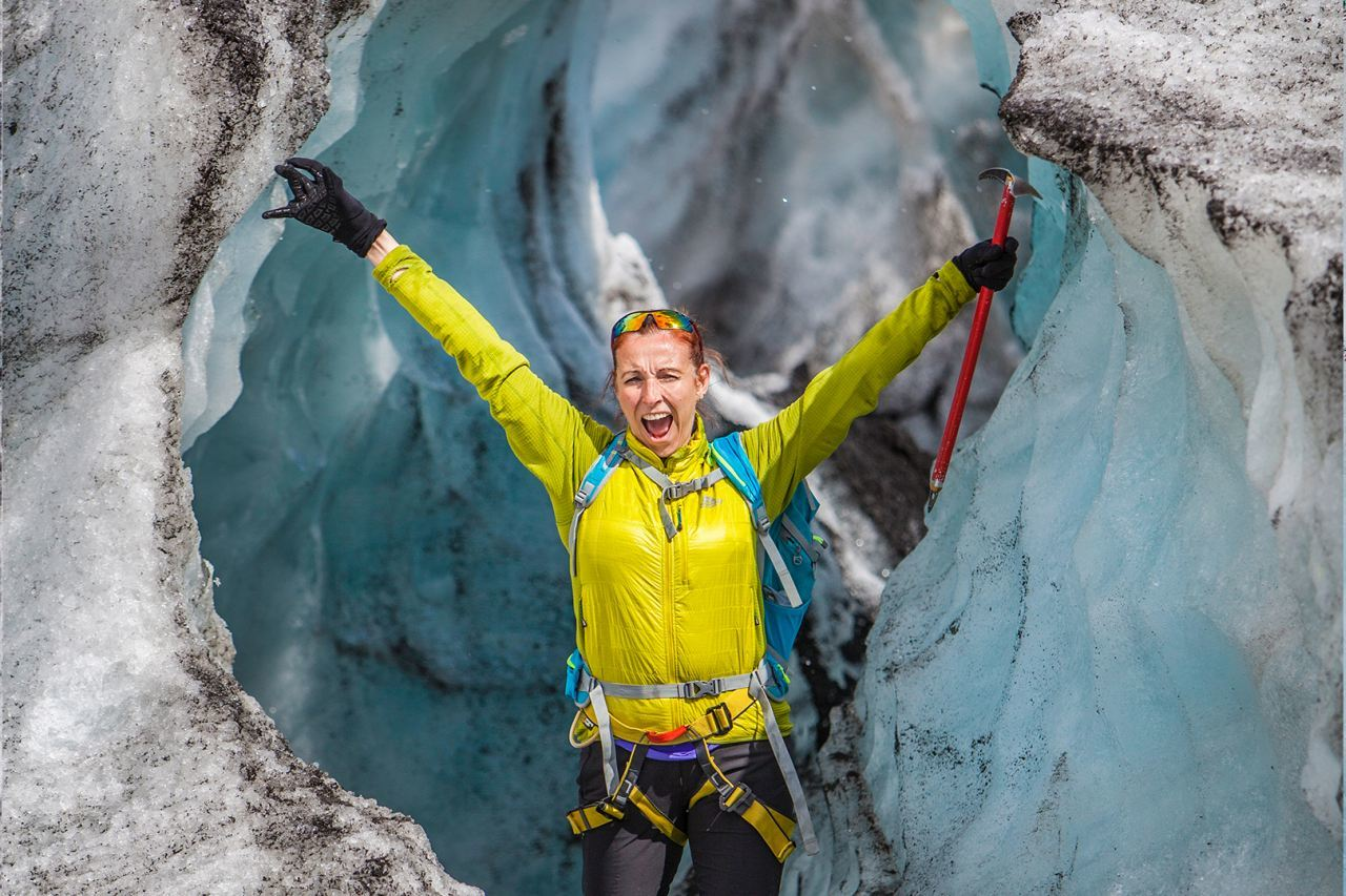 Smiling in a glacier tunnel on Solheimajokull - South Shore Glacier Walk and Ice Climbing with Iceland Mountain Guides