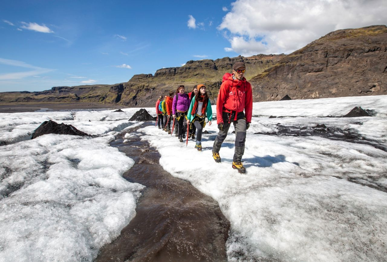 Glacier Walk tour along a stream of fresh glacier water on Sólheimjökull glacier with Icelandic Mountain Guides