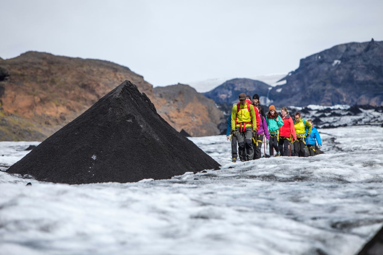 Mound of volcanic ash during a Glacier Walk on Sólheimajökull Glacier with Icelandic Mountain Guides