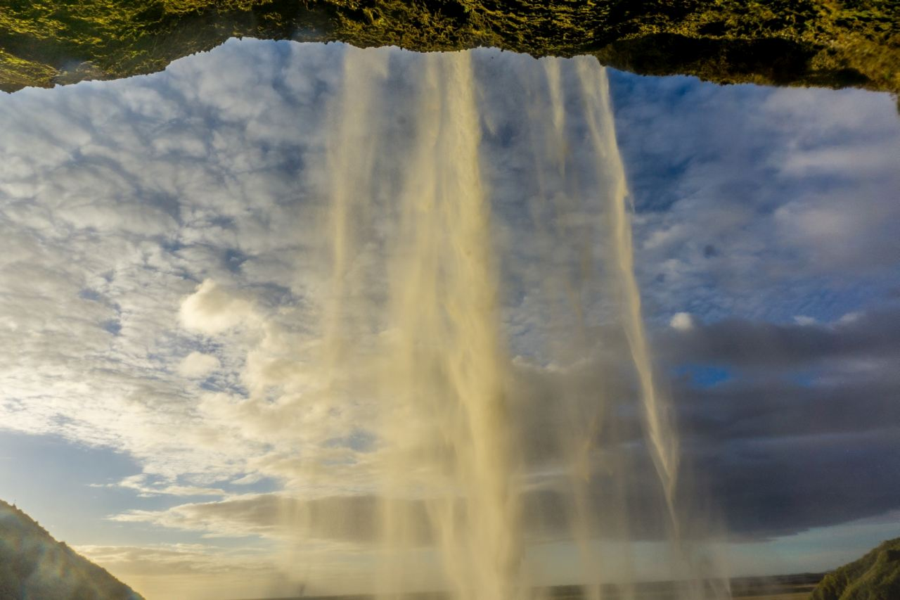 Go behind Seljalandsfoss waterfall in Iceland with Icelandic Mountain Guides