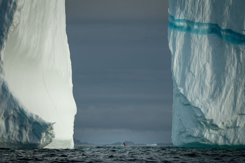 Boast between two icebergs in Greenland