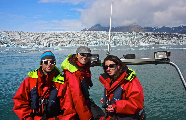 Happy people exploring the glacier lagoon