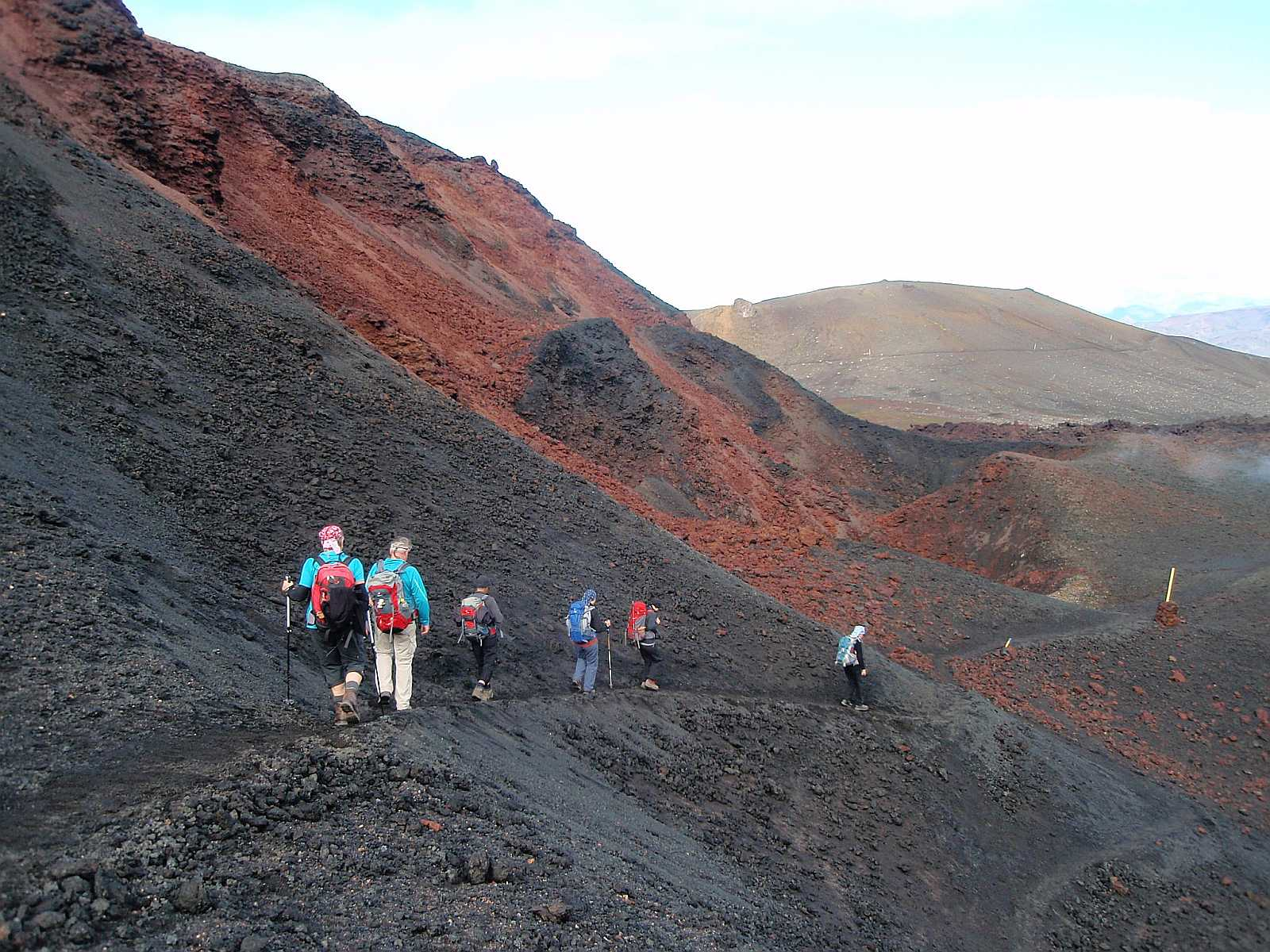 Hikers go through the fresh lavafield