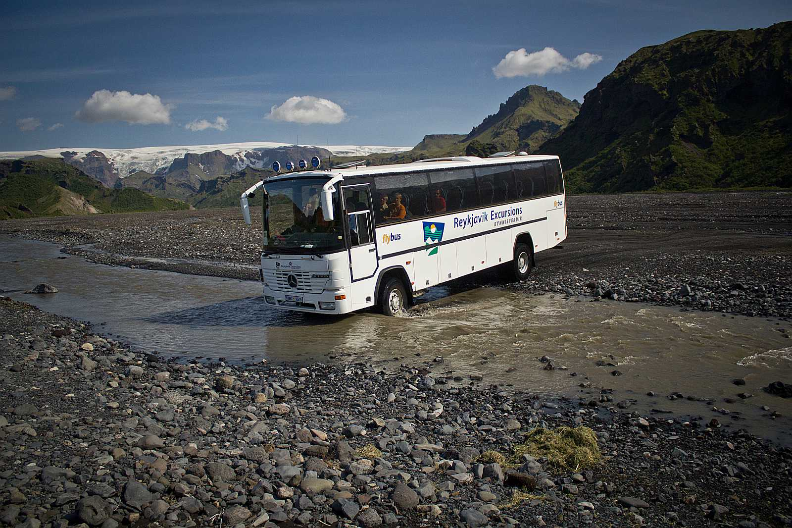Bus crossing a river near Þórsmörk