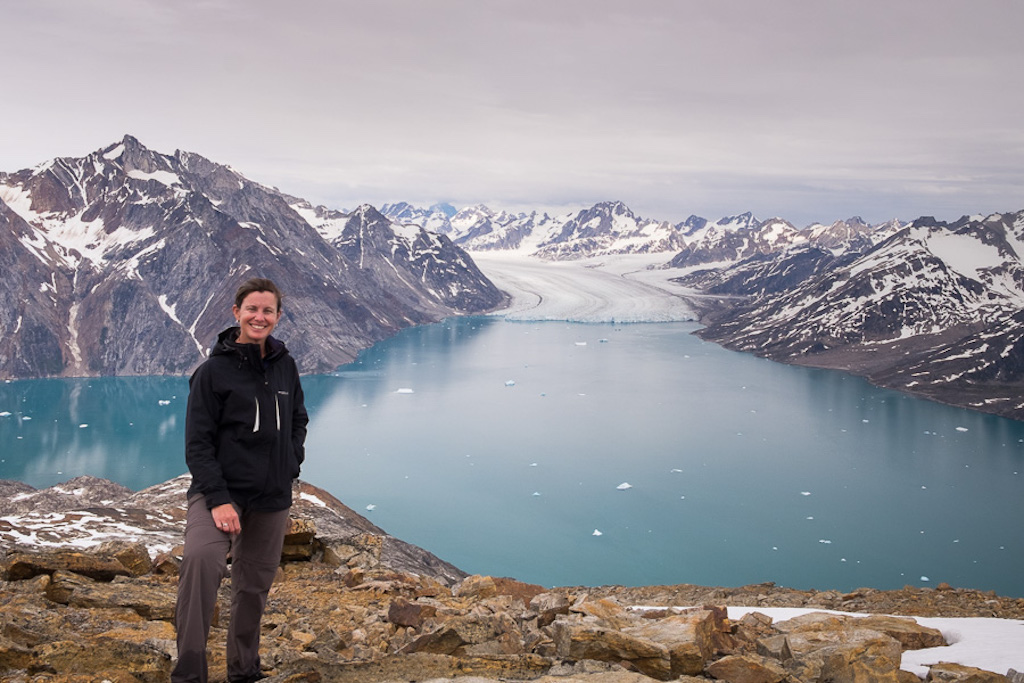 Lisa enjoying the amazing views of East Greenland while trekking the Unplugged Wilderness trail