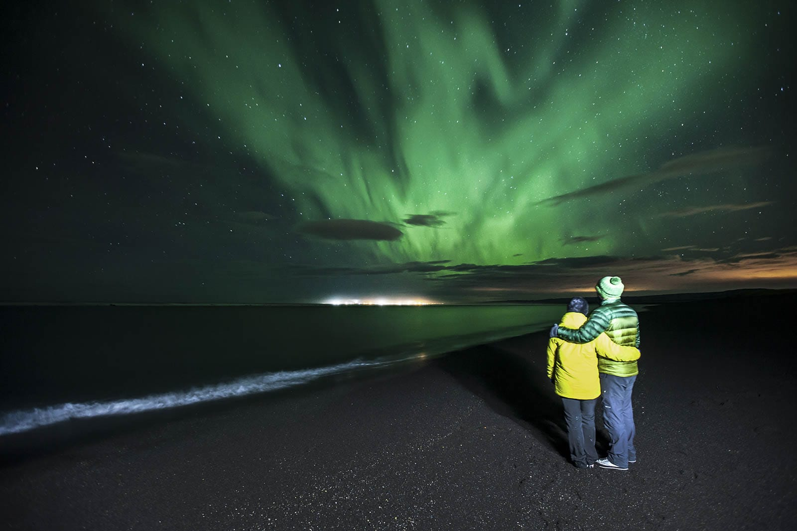 By the ocean looking at the northern lights