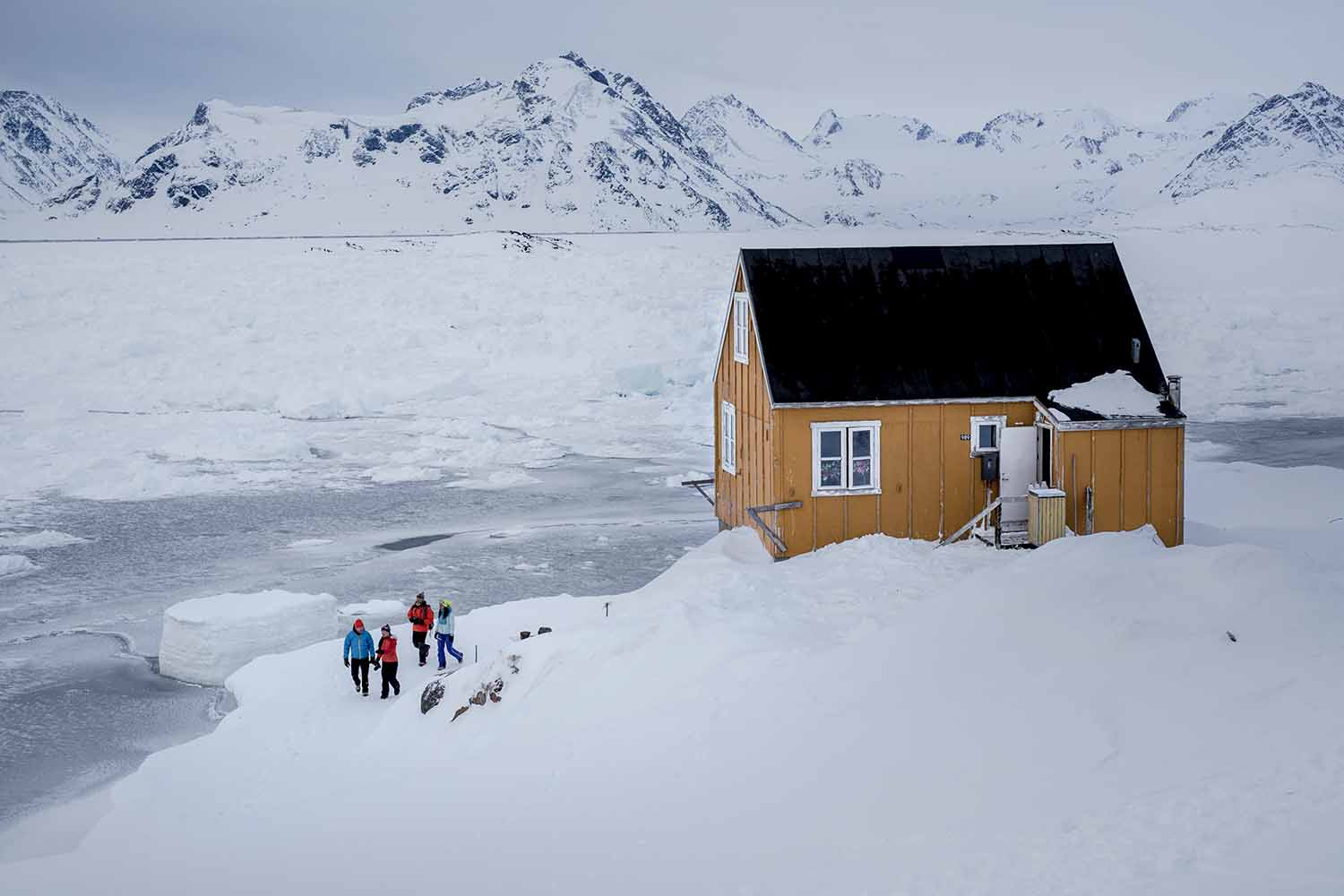 Kulusuk house, surrounded with pack Ice
