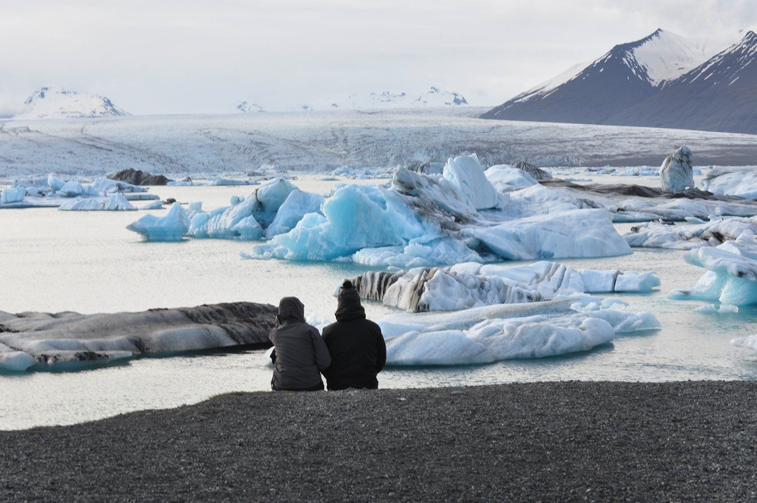 The glacier lagoon is fed by the glacier in the backgound